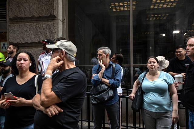 Commuters are seen on Fulton Street after the Fulton Street subway station was closed as police investigated two suspicious packages in Manhattan, New York, U.S. August 16, 2019. REUTERS/Stephen Yang