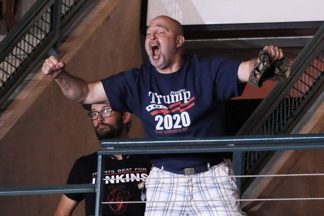 Trump supporter Frank Dawson cheers after helping to eject a small group of protesters during U.S. President Donald Trump's rally with supporters in Manchester, New Hampshire U.S. August 15, 2019. REUTERS/Jonathan Ernst