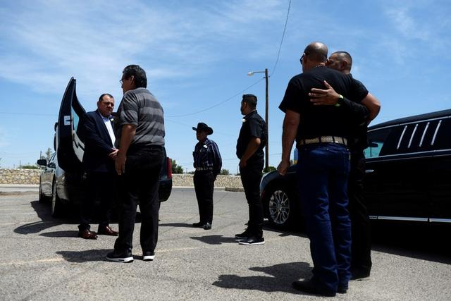 FILE PHOTO: Friends and family surround the casket of Juan Velazquez, six days after a mass shooting at a Walmart store in El Paso, Texas, U.S. August 9, 2019.  REUTERS/Callaghan O'Hare/File Photo