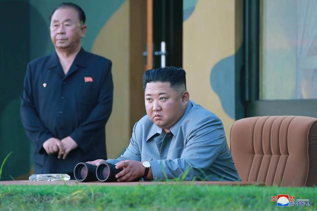 FILE PHOTO: North Korean leader Kim Jong Un watches the test-fire of two short-range ballistic missiles on Thursday, in this undated picture released by North Korea's Central News Agency (KCNA) on July 26, 2019.  KCNA/via REUTERS