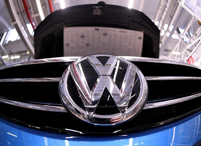 FILE PHOTO: A Volkswagen logo is pictured in a production line at the Volkswagen plant in Wolfsburg, Germany March 1, 2019. REUTERS/Fabian Bimmer/File Photo