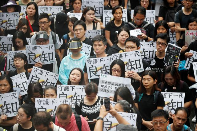 Teachers protest against the extradition bill during a rally organised by Hong Kong Professional Teachers' Union in Hong Kong, China August 17, 2019. REUTERS/Kim Hong-Ji