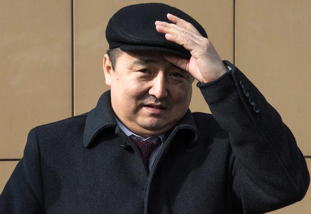 FILE PHOTO: Kazakh rights activist Serikzhan Bilash walks outside a courthouse in Almaty, Kazakhstan, February 13, 2019.  REUTERS/Mariya Gordeyeva/File Photo