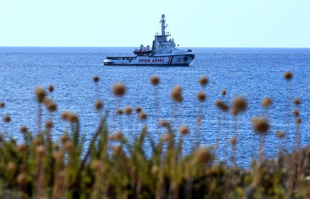 Spanish migrant rescue ship Open Arms lies anchored close to the Italian shore in Lampedusa, Italy August 17, 2019. REUTERS/Guglielmo Mangiapane