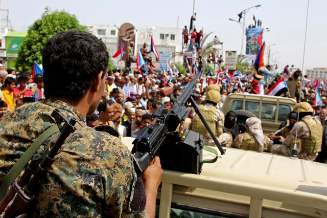 FILE PHOTO: Members of UAE-backed southern Yemeni separatists forces are seen together with their supporters as they march during a rally in southern port city in Aden, Yemen August 15, 2019. REUTERS/Fawaz Salman/File Photo