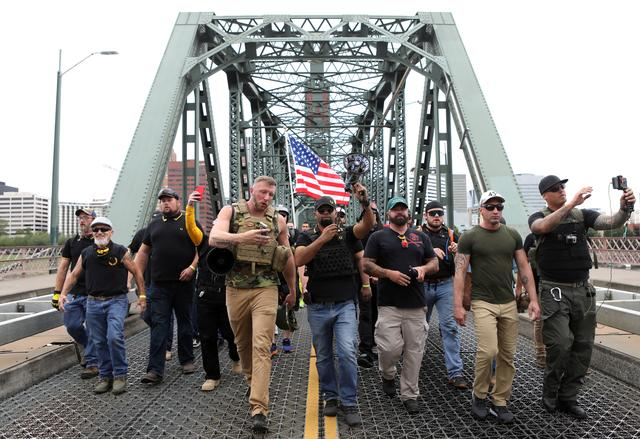 Members of the Proud Boys and their supporters march during a rally in Portland, Oregon, U.S., August 17, 2019. REUTERS/Jim Urquhart