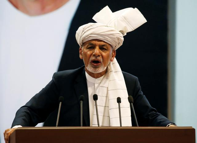 FILE PHOTO: Afghanistan's President Ashraf Ghani speaks during a consultative grand assembly, known as Loya Jirga, in Kabul, Afghanistan April 29, 2019. REUTERS/Omar Sobhani/File Photo