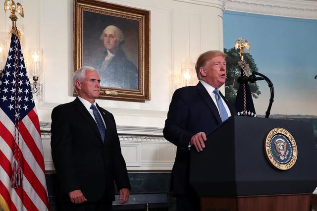 FILE PHOTO: U.S. President Donald Trump speaks about the shootings in El Paso and Dayton as Vice President Mike Pence looks on in the Diplomatic Room of the White House in Washington, U.S., August 5, 2019. REUTERS/Leah Millis
