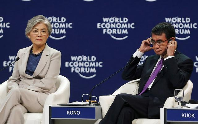 FILE PHOTO - South Korea's Foreign Minister Kang Kyung-Wha (L) and Japan's Foreign Minister Taro Kono attend the Asia's Geopolitical Outlook during the World Economic Forum on ASEAN at the National Convention Center in Hanoi, Vietnam September 13, 2018. REUTERS/Kham