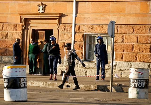 Riot police officers keep watch outside the Tredgold Building Magistrate court in Bulawayo, Zimbabwe, August 19, 2019. REUTERS/Philimon Bulawayo