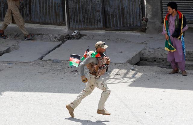 A member of Afghan security forces runs after a blast in Jalalabad, Afghanistan August 19, 2019. REUTERS/Parwiz
