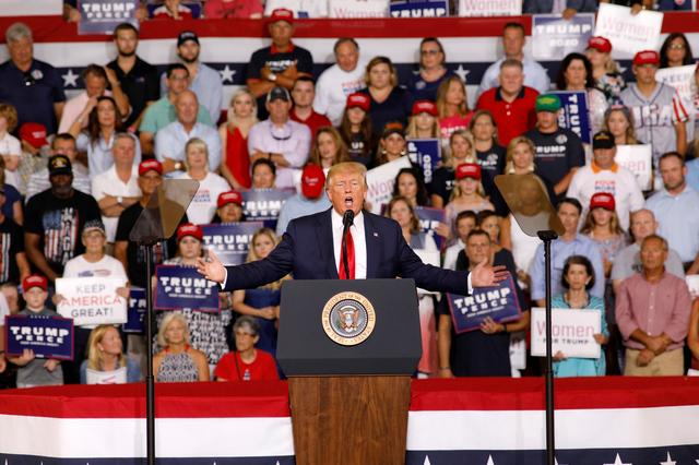 """FILE PHOTO: U.S. President Donald Trump speaks about U.S. Representative Ilhan Omar, and the crowd responded with """"send her back"""", at a campaign rally in Greenville, North Carolina, U.S., July 17, 2019.   REUTERS/Jonathan Drake/File Photo"""