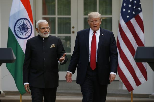 FILE PHOTO: U.S. President Donald Trump (R) arrives for a joint news conference with Indian Prime Minister Narendra Modi in the Rose Garden of the White House in Washington, U.S., June 26, 2017. REUTERS/Kevin Lamarque