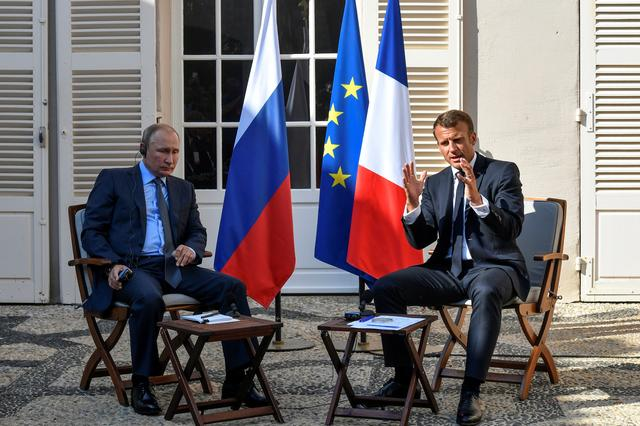 French President Emmanuel Macron meets with Russia's President Vladimir Putin, at his summer retreat of the Bregancon fortress on the Mediterranean coast, near the village of Bormes-les-Mimosas, southern France, on August 19, 2019. Gerard Julien/Pool via REUTERS