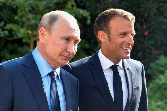 French President Emmanuel Macron welcomes Russia's President Vladimir Putin, at his summer retreat of the Bregancon fortress on the Mediterranean coast, near the village of Bormes-les-Mimosas, southern France, on August 19, 2019. Gerard Julien/Pool via REUTERS
