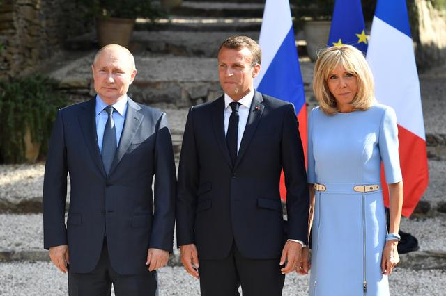 French President Emmanuel Macron and his wife Brigitte Macron pose with Russia's President Vladimir Putin, at the French President's summer retreat of the Bregancon fortress on the Mediterranean coast, near the village of Bormes-les-Mimosas, southern France, on August 19, 2019. Gerard Julien/Pool via REUTERS