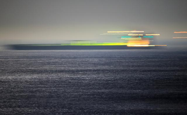 Iranian oil tanker Adrian Darya 1, previously named Grace 1, sails after the Supreme Court of the British territory lifted its detention order, in the Strait of Gibraltar, Spain, August 19, 2019. Picture taken with long exposure. REUTERS/Jon Nazca