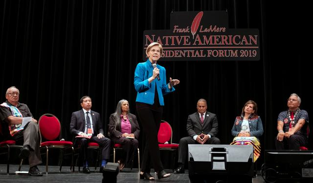 U.S. 2020 Democratic presidential candidate and U.S. Senator Elizabeth Warren stands in front of Native American tribal leaders as she speaks at the Frank LaMere Native American Forum while campaigning in Sioux City, Iowa, U.S., August 19, 2019. REUTERS/Alex Wroblewski