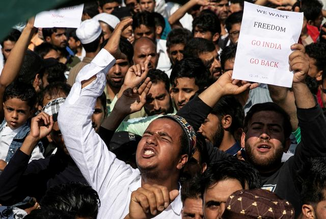 FILE PHOTO: Kashmiris attend a protest after Eid-al-Adha prayers at a mosque during restrictions following the scrapping of the special constitutional status for Kashmir by the Indian government, in Srinagar, August 12, 2019. REUTERS/Danish Siddiqui/File Photo