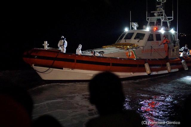 An Italian coast guard vessel is seen near Spanish rescue ship Open Arms near Lampedusa, Italy in this undated handout picture provided by the Spanish NGO Open Arms on August 19, 2019. Francisco Gentico/Open Arms/Handout via REUTERS