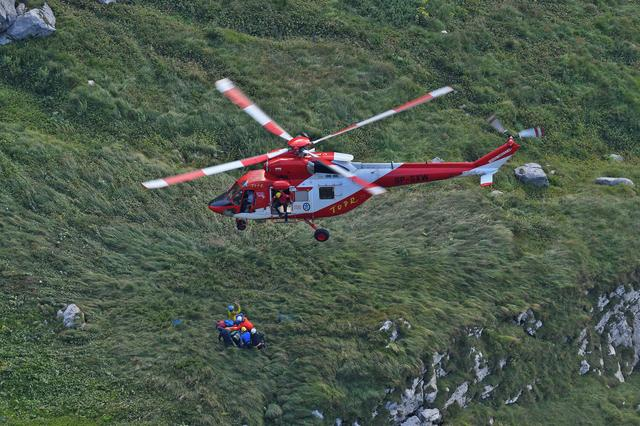Mountain rescue team (TOPR) helicopter is pictured in Tatra mountains during a search mission to save two cavers trapped in a cavern, near Zakopane, Poland August 19, 2019. REUTERS/Bartlomiej Jurecki