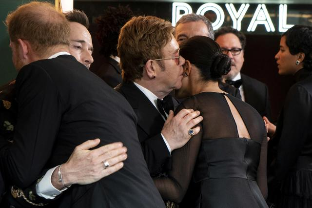 FILE PHOTO: Britain's Prince Harry, Duke of Sussex, greets Canadian producer David Furnish as British singer-songwriter Elton John speaks with Britain's Meghan, Duchess of Sussex, as they arrive for the European premiere of the film The Lion King in London, Britain July 14, 2019. Niklas Halle'n/Pool via REUTERS/File Photo