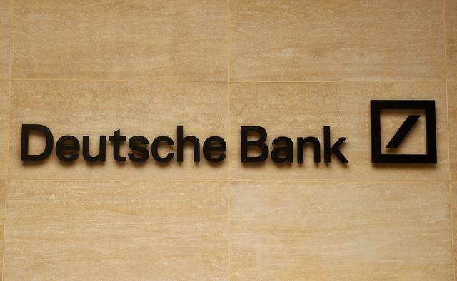 FILE PHOTO: The logo of Deutsche Bank is pictured on a company's office in London, Britain July 8, 2019. REUTERS/Simon Dawson/File Photo