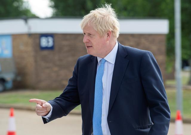 FILE PHOTO: Britain's Prime Minister Boris Johnson visits the Fusion Energy Research Centre at the Fulham Science Centre in Oxfordshire, Britain August 8, 2019. Julian Simmonds