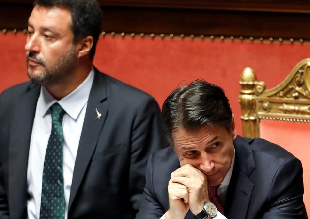 Italian Deputy PM Matteo Salvini and Italian Prime Minister Giuseppe Conte attend a session of the upper house of parliament over the ongoing government crisis, in Rome, Italy August 20, 2019. REUTERS/Yara Nardi