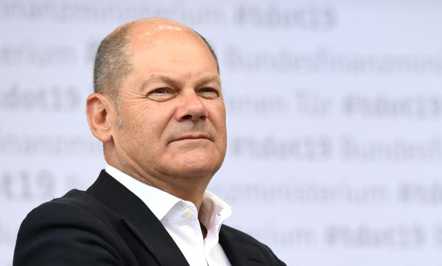 """FILE PHOTO: German Vice Chancellor and Finance Minister Olaf Scholz looks on during the """"Open Door Day"""" of the Federal Ministry of Finance in Berlin, Germany, August 17, 2019. REUTERS/Annegret Hilse/File Photo"""