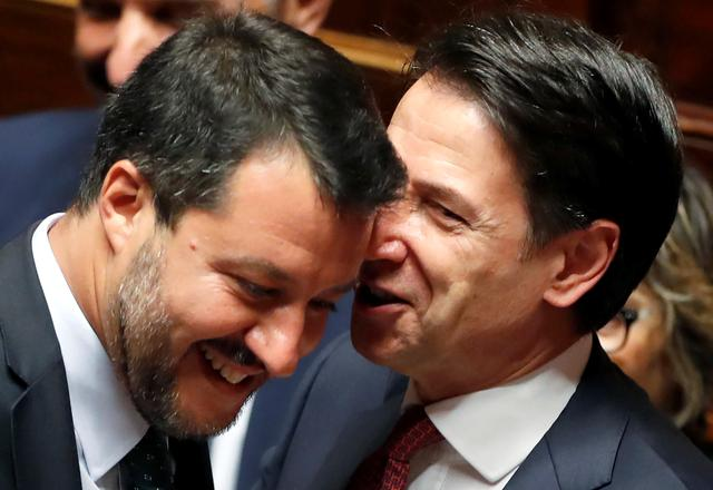 Italian Prime Minister Giuseppe Conte speaks with Italian Deputy PM Matteo Salvini before addressing the upper house of parliament over the ongoing government crisis, in Rome, Italy August 20, 2019. REUTERS/Yara Nardi