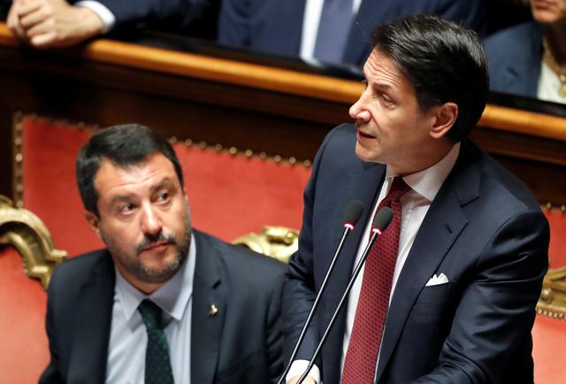 Italian Prime Minister Giuseppe Conte, next to Italian Deputy PM Matteo Salvini, addresses the upper house of parliament over the ongoing government crisis, in Rome, Italy August 20, 2019. REUTERS/Yara Nardi