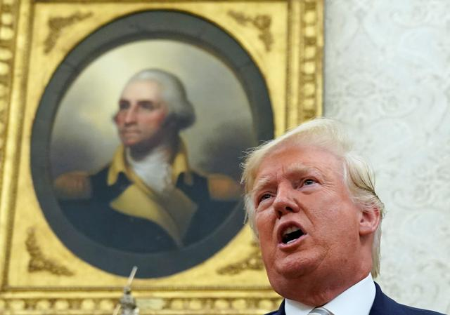 With a painting of George Washington in the background, U.S. President Donald Trump speaks during his meeting with Romania's President Klaus Iohannis in the Oval Office of the White House in Washington, U.S. August 20, 2019. REUTERS/Kevin Lamarque