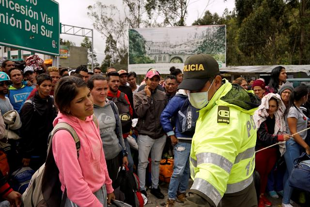FILE PHOTO: Venezuelans gather to cross into Ecuador from Colombia, most of them trying to reach Peru as one of the most welcoming destinations for migrants in South America, in Tulcan, Ecuador June 15, 2019. REUTERS/Daniel Tapia/File Photo