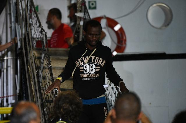 Spanish rescue ship Open Arms with migrants on board arrives in Lampedusa, Italy, August 20, 2019. REUTERS/Guglielmo Mangiapane