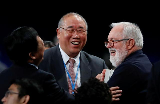 FILE PHOTO: Miguel Canete, EU Comissioner, and head of Chinese delegation Xie Zhenhua react after adopting the final agreement during a closing session of the COP24 U.N. Climate Change Conference 2018 in Katowice, Poland, December 15, 2018. REUTERS/Kacper Pempel