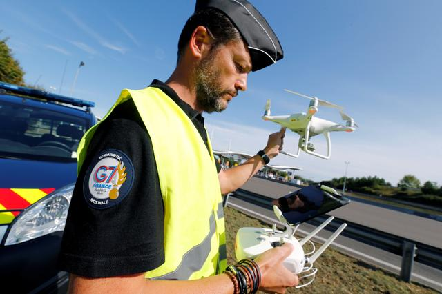 A French Gendarme checks a drone before a flight near a toll station in Anglet ahead of the G7 Summit in the French coastal resort of Biarritz, France, August 21, 2019.  REUTERS/Regis Duvignau