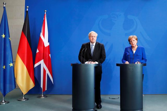 German Chancellor Angela Merkel and Britain's Prime Minister Boris Johnson attend a news conference at the Chancellery in Berlin, Germany August 21, 2019. REUTERS/Fabrizio Bensch