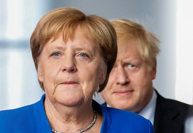 German Chancellor Angela Merkel and Britain's Prime Minister Boris Johnson attend a news conference at the Chancellery in Berlin, Germany, August 21, 2019. REUTERS/Axel Schmidt
