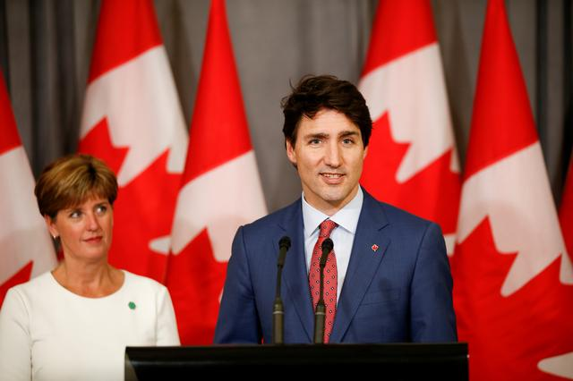 FILE PHOTO: Canada's Prime Minister Justin Trudeau and Canada's Minister for International Development Marie-Claude Bibeau attend a news conference at Canada's Embassy in London, Britain, April 19, 2018. REUTERS/Henry Nicholls