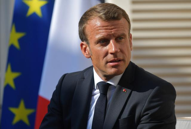 FILE PHOTO: French President Emmanuel Macron attends a meeting with Russian President Vladimir Putin at Fort Bregancon near the village of Bormes-les-Mimosas, France August 19, 2019. Sputnik/Alexei Druzhinin/Kremlin via REUTERS