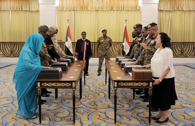 Leader of Sudan's transitional council, Lieutenant General Abdel Fattah Al-Abdelrahman Burhan looks on as military and civilian members of Sudan's new ruling body, the Sovereign Council, are sworn in at the presidential palace in Khartoum, Sudan, August 21 2019. REUTERS/Stringer