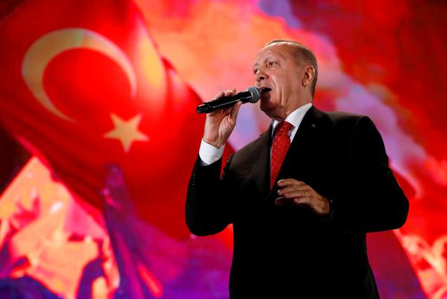 FILE PHOTO: Turkish President Tayyip Erdogan addresses his supporters during a ceremony marking the third anniversary of the attempted coup at Ataturk Airport in Istanbul, Turkey, July 15, 2019. REUTERS/Murad Sezer/File Photo