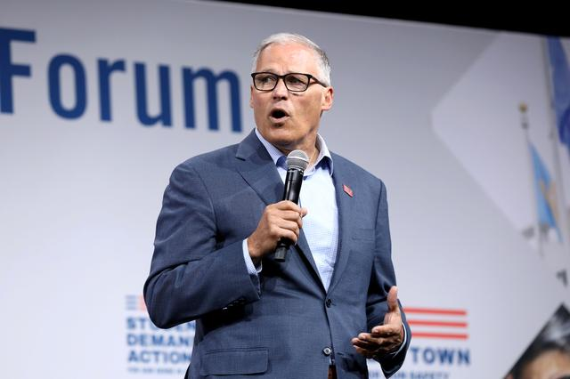 FILE PHOTO: 2020 Democratic U.S. presidential candidate and Washington Governor Jay Inslee speaks during the Presidential Gun Sense Forum in Des Moines, Iowa, U.S., August 10, 2019. REUTERS/Scott Morgan/File Photo