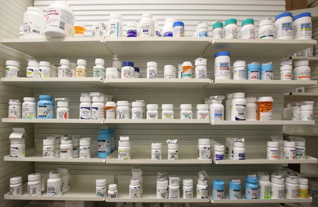FILE PHOTO: Bottles of drugs sit on the shelf at the Rock Canyon Pharmacy, in Provo, Utah, U.S., May 9, 2019. REUTERS/GEORGE FREY