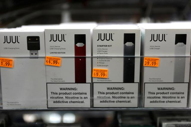 FILE PHOTO: Juul brand vaping pens are seen for sale in a shop in Manhattan in New York City, New York, U.S., February 6, 2019. REUTERS/Mike Segar
