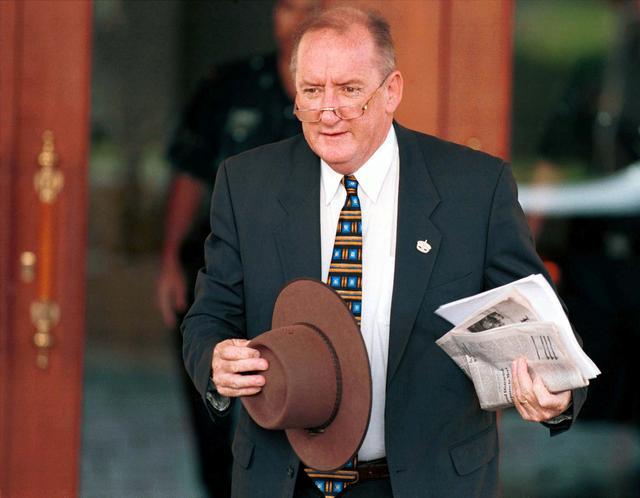 FILE PHOTO: Australian Trade Minister Tim Fischer arrives for the second day of the 10th Asia-Pacific Economic Cooperation (APEC) Ministerial Meeting in Kuala Lumpur November 15, 1998. REUTERS/Bobby Yip/File Photo