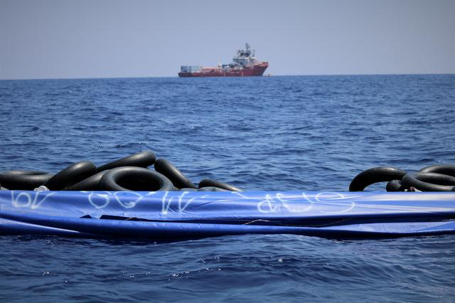 The migrant rescue ship Ocean Viking, run by French charities Medecins Sans Frontieres and SOS Mediterranee, floats in the distance, as it waits in international waters between Malta and the southern Italian island of Linosa for access to a port in this handout picture taken between August 9 and 12, 2019. Ocean Viking/Handout via REUTERS