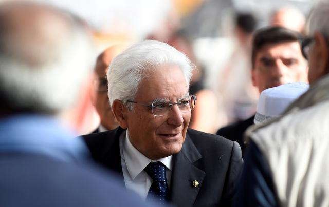 FILE PHOTO: Italian President Sergio Mattarella arrives for the ceremony marking the first anniversary of the collapse of a motorway Morandi Bridge that killed 43 people in Genoa, Italy, August 14, 2019. REUTERS/Massimo Pinca/File Photo