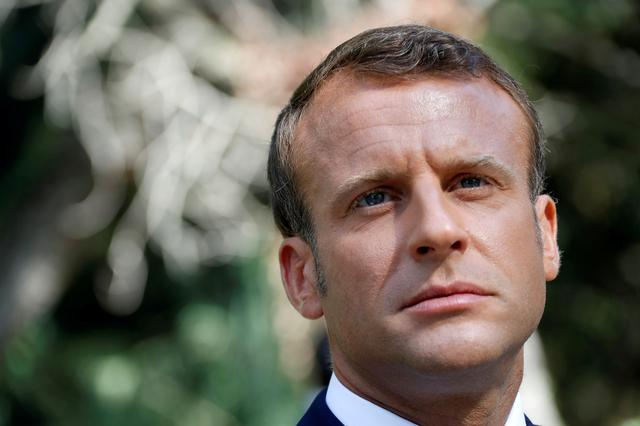 FILE PHOTO: French President Emmanuel Macron reacts as he arrives at a ceremony marking the 75th anniversary of the Allied landings in Provence in World War Two which helped liberate southern France, in Boulouris, France, August 15, 2019.  REUTERS/Eric Gaillard/File Photo